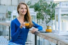 Young pretty woman enjoys cup of tea Stock Photos