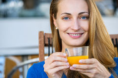 Young pretty woman enjoys cup of tea Royalty Free Stock Photography