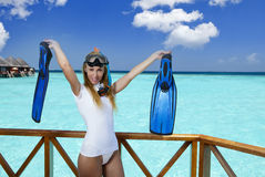 The young pretty woman in equipment for a snorkeling on the sundeck over the sea. Maldives Stock Image
