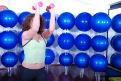 Young pretty woman exercising in a fitness center Stock Photo