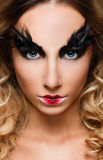 Young pretty woman face with false feather eyelashes fashion makeup Stock Photo