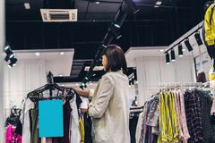 Young pretty woman in the fashion store. Shopping concept. stock photography
