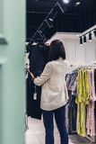 Young pretty woman in the fashion store. Shopping concept. royalty free stock photo