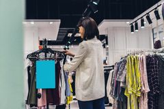 Young pretty woman in the fashion store. Shopping concept. royalty free stock photos