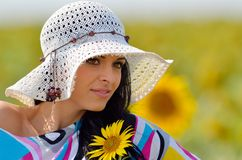 Young pretty woman on field Stock Image