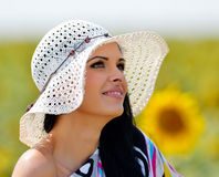 Young pretty woman on field in summer Royalty Free Stock Photos