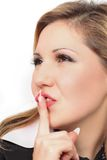Young pretty woman with finger on lips Stock Photography