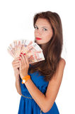 Young pretty woman with freckles holds cash Stock Images