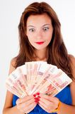 Young pretty woman with freckles holds cash. Young girl with freckles cools herself with a fan of money Stock Photography
