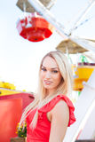 Young pretty woman in front of a Ferris wheel Stock Images