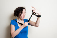 Young pretty woman with funny surprised expression while observi Stock Images