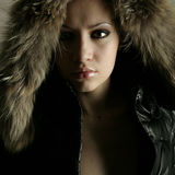 Young pretty woman with fur Stock Photo