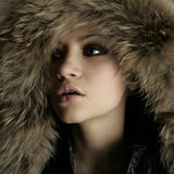 Young pretty woman with fur Royalty Free Stock Photo