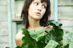 Young pretty woman in the garden Stock Photo
