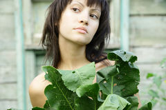 Young pretty woman in the garden Royalty Free Stock Photography