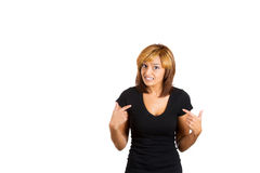 Young pretty woman getting mad and pointing at herself s if to ask you talking to me? Royalty Free Stock Photography