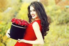 smiling girl with red roses stock images
