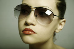 Young pretty woman with glasses Stock Photography