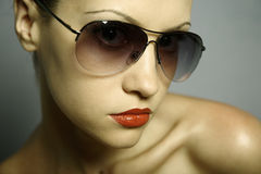 Young pretty woman with glasses stock image