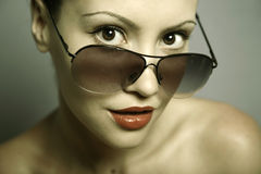 Young pretty woman with glasses Royalty Free Stock Images