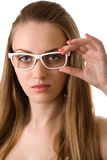 Young pretty woman in glasses isolated on white Royalty Free Stock Photos