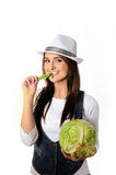 Young pretty woman with green beautiful cabbage Stock Image