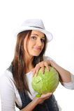 Young pretty woman with green cabbage Royalty Free Stock Photos