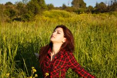 Young woman. Young pretty woman in green field Royalty Free Stock Photography