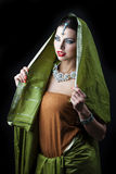 Young pretty woman in green indian dress Royalty Free Stock Image