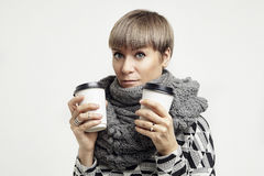 Young pretty woman in a grey outfit having a coffee from paper cups. Takeaway package design layout. Stock Photo