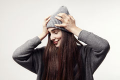 Young pretty woman in a grey outfit hold a head. Hipster style Royalty Free Stock Photos