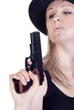 Young pretty woman with a gun Royalty Free Stock Photos