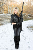 Young pretty woman with a gun Royalty Free Stock Photo