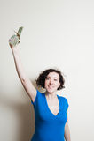 Young pretty woman happy showing dollars arm up Royalty Free Stock Photography