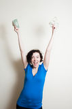 Young pretty woman happy showing dollars arms up Royalty Free Stock Photography