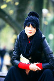 Young pretty woman in hat at the autumn park. Stock Photography
