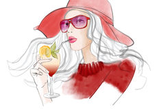 Young pretty woman with hat having a cocktail Stock Photo