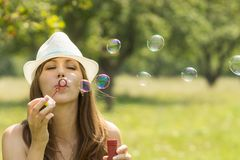 Young pretty woman have fun with bubble in summer park Royalty Free Stock Photo