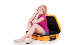 Young pretty woman having fun sitting in travel Stock Photography
