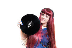 Young pretty woman with headphones and vinyl disk Stock Images