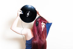 Young pretty woman with headphones and vinyl disk Stock Photo