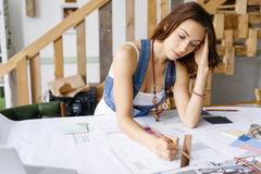 Young pretty woman at her desk Stock Photos