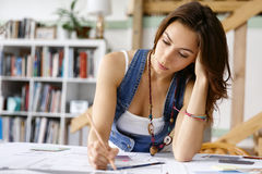 Young pretty woman at her desk Royalty Free Stock Photography
