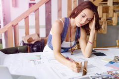 Young pretty woman at her desk Stock Images