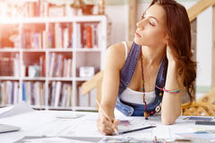 Young pretty woman at her desk Royalty Free Stock Photo