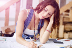 Young pretty woman at her desk Stock Photo
