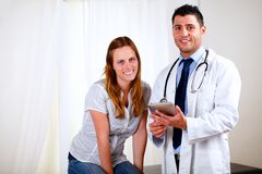 Young pretty woman with her medical doctor Royalty Free Stock Photography