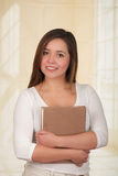 Young Pretty Woman Hiding Behind Open Book Stock Photography