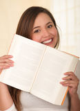 Young Pretty Woman Hiding Behind Open Book Royalty Free Stock Photo