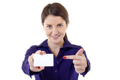 Young pretty woman holding blank business card. Portrait of young pretty woman holding blank business card Royalty Free Stock Image